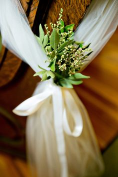DIY wedding pew markers, made with greenery from my great-aunts yard.   #kristigerdesphotography