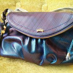NEW Juicy Couture Crossbody Juicy Couture Mini Crossbody handbag. Color varies depending on light between iridescent blue/purple. Top has small zipper pocket; small zipper pocket inside. Juicy Couture Bags Crossbody Bags