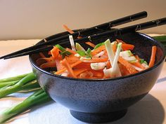 Mary Ellen Carter created this tangy Asian Coleslaw recipe, featuring raw kohlrabi. I really like the idea of using chop sticks! Asian Coleslaw, Asian Slaw, Sweet Carrot, Slaw Recipes, Food Items, Entrees, Carrots, Nom Nom, Vegetarian Recipes