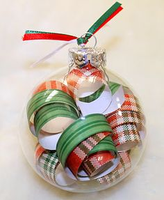 Scrap Paper Filled Ornament. great idea for ornament gifts next year. wish we didn't recycle all the paper!