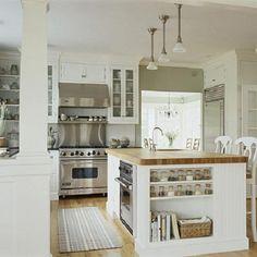 Clean, white kitchen with #butcherblock island.