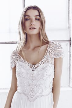 Anna Campbell bridal Ceremony Collection. Anna Silk Tulle dress. Available in ivory + bone. Hand beaded and perfect for the bride looking for a little vintage flare. Made in Australia.