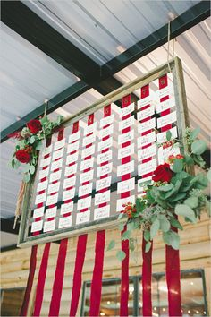 diy wedding seating assignment display for red and green wedding
