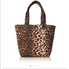 Big SALE!! NWT Steve Madden Leopard tote NwT Steve Madden leopard nylon tote. Zipper top. Zipper slot inside with 2 cell phone pockets. Perfect condition. Measurements: Bottom Width: 17 in Depth: 7 1⁄2 in Height: 13 in Strap Length: 22 in Strap Drop: 9 1⁄2 in Weight: 14 oz Steve Madden Bags Totes