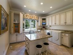 Traditional Laundry Room with European Cabinets, Complex granite counters, Crown molding, L-shaped, Breakfast bar