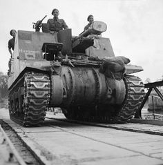 ARMOURED DIVISION ADVANCE OVER SEINE AUGUST 1944 (B 9807) A Sexton 25-pounder self-propelled gun of 11th Armoured Division crosses the River Seine on a Bailey bridge, 30 August 1944