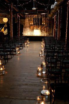 Candlelit aisle in a vintage venue.