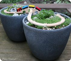 """Super easy way to make a DIY outdoor wooden train """"table""""...no tools required to make this mini garden railway!"""
