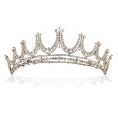An Edwardian diamond tiara, with foliate swags and floral motifs graduating from the centre, set in white throughout with old brilliant-cut and rose-cut diamonds estimated to weigh a total of 8 carats, all to a yellow gold mount with detachable frame, convertible into a necklace, circa 1910.