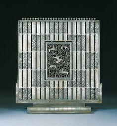 A WROUGHT-IRON FIRESCREEN EDGAR BRANDT, CIRCA 1925