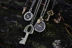 Pyrrha talismans and key necklaces