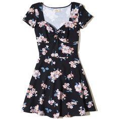 Hollister Twist-Front Skater Dress ($20) ❤ liked on Polyvore featuring dresses, navy floral, navy blue skater dress, floral dresses, navy blue floral dress, skater skirt dress and navy dresses