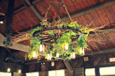Our wagon wheel chandelier located in our Allison Peabody Hall was decorated for a wedding. What a simple, but beautiful touch!!! #abemartinlodge #rustic #wedding  - Brown County State Park - Nashville IN