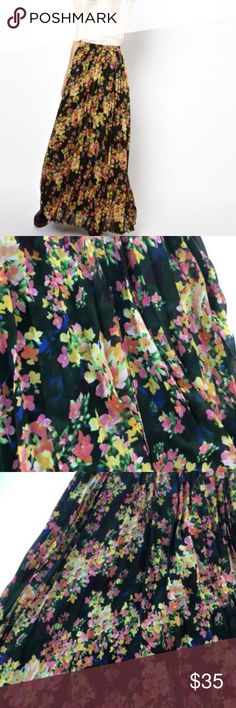 """ASOS floral printed pleated maxi skirt ASOS floral printed pleated maxi skirt size 6 Waist: 14"""" across Length: 42"""" zipper on the side lined hand wash pleated flower print on a black background 100% polyester ASOS Skirts Maxi"""