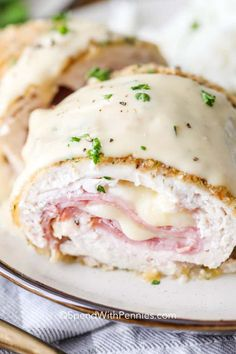 Chicken Cordon Bleu – Spend With Pennies Tender chicken wrapped around slices of ham and swiss cheese, this Easy Chicken Cordon Bleu recipe a favorite. Baked instead of fried, this dish is simple to prepare and topped with a creamy dijon sauce! Chicken Cordon Bleu Sauce, Sauce For Chicken, Oven Baked Chicken, Chicken Recipes, Breaded Chicken, Grilled Chicken, Crusted Chicken, Chicken Pasta, Cordon Bleu Recipe