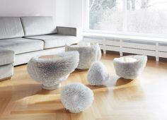 Pia Maria Raeder arranged three side tables and two sculptural pieces – made from more than 16,000 beech rods in total – to form the Sea Anemones White installation.