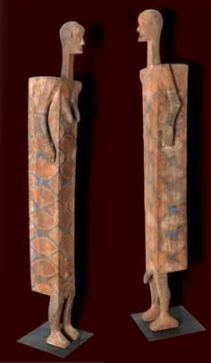 Africa | Coffins (male and female form) from the Ngata / Ntomba people of Congo | Wood, with pigment | These types of coffins would have been used to bury individuals of high status, such as the chief.