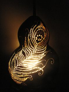 Peacock Feathers Gourd Lamp by TheGoldenGourd on Etsy. Wondering if you could do something like this on canvas, with lights behind.