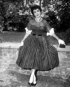 *-f*Wardrobe Wednesday: Ms. Taylor sits pretty in pinstripes and pearls.