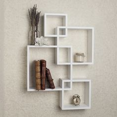 Add a fun and playful flair to your living space with the Danya B Intersecting Cube Shelves White. Intersecting cubes create an alluring geometric wall art that doubles as a functional shelf for books Cube Shelves, Wall Mounted Shelves, Display Shelves, Storage Shelves, Shelving, White Shelves, Cubbies, Unique Wall Shelves, White Bookshelves