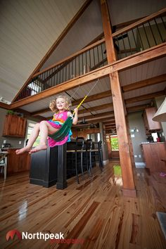 Put a swing inside your house! This post and beam Yankee Barn Homes has a swing in the kitchen!