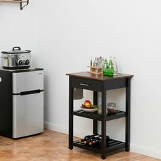 This thoughtfully designed kitchen cart is a perfect piece of furniture to help you reorganize your kitchen space! One large drawer and two open shelves provide ample storage for your kitchen and dining essentials. Kitchen Island Trolley, Wood Cart, Kitchen Arrangement, Rolling Kitchen Island, Rolling Storage Cart, Display Shelves, Open Shelving, Storage Spaces, Kitchen Dining