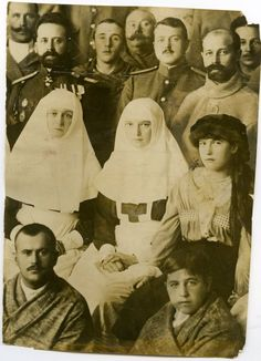 Empress Alexandra Feodorovna and Grand Duchesses Tatiana and Anastasia with wounded soldiers, 1916 - Maria's crush, Nicholas Demenkov, is standing behind Tatiana