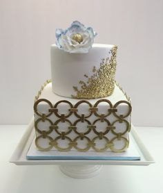 Modern gold and blue fondant wedding cake by Frost It Cakery with edible gold sequins