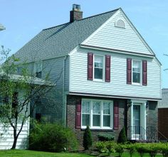 maroon shutters grey roof