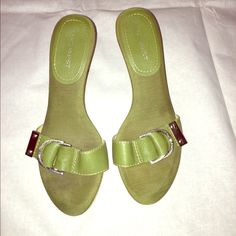 Green sandals with leather buckle by Nine West Green cloth slide-in sandal with leather/silver metal buckle, and light colored wood. Short 2 inch heel, very comfortable shoes. Size 7. Nine West Shoes Sandals