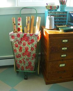 Vintage shopping cart - lined and used as wallpaper storage & organizer with small drawers (paint it!)