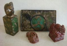 """Three Hand Carved Ink Stamps and A Netsuke: Rectangular Carved Chinese Tortoise Stone, Stamp/Seal Varigated. Hand Carved Gold Colored Agate w/Resting Dragon Netsuke 1 1/4""""L. Polished Ink Stone Stamp/Seal, Uncarved, 1 1/2""""T w/Chop Mark. Stylized Dragon Ink Stamp, Carved, 3""""T. (180-260)"""