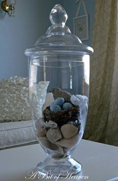 nest with silver bird in apothocary jar