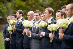 Groomsmen acting like bridesmaids. Fake crying smiling like how they think the maids act