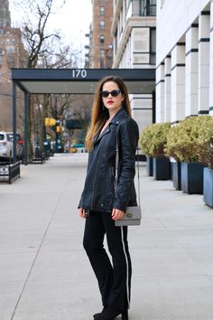 Spring outfit ideas. Leather jacket, track pants, sock booties.