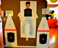 "NERF party with Justin Bieber!  Too funny.  Sign reads not to shoot the ""Biebs"" because you wouldn't hit an unarmed boy.  Instead aim for the bombs."