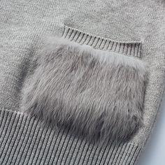 fur pocket on a knit