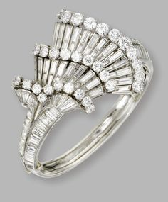 Platinum and diamond bangle bracelet, circa 1940. The hinged bangle set with round and baguette diamonds weighing a total of approximately 34.50 carats.