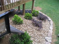 We decided to use pea gravel for the rock. Dh brought home 2 scoops today and we put it out. We figure another 2 scoops should finish up thi. Under Deck Landscaping, Gravel Landscaping, Sloped Backyard, Landscaping With Rocks, Backyard Patio, Backyard Ideas, Outside House Decor, Lawn And Landscape, Desert Landscape