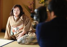 Yasue Tomita, 61, sits on a tatami floor while posing for a photographer as she makes her debut as a porn actress at a studio in Tsurugashima, Saitama prefecture.
