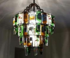 The beer bottle chandelier is the ultimate lighting source for a home bar or enclosed patio. Made from real beer bottles, the beer bottle chandelier is a beautiful source of light that displays many colors and makes a great house warming gift. Beer Bottle Chandelier, Beer Bottle Lights, Recycled Bottle Crafts, Recycled Glass, Recycled Art, Beer Bottle Crafts, Beer Crafts, Empty Bottles, Beer Bottles