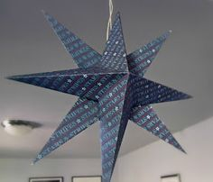 Ameroonie Designs: Folded Paper Star Tutorial. I'm SO making these as part of my Christmas decorations - depending on the type of paper I use, I may even be able to poke/punch some decorative holes and add some battery-operated light packs inside! No more need to buy the pre-made store versions anymore. :)