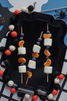 Halloween Fruit Skewers.  Looking for some fun halloween food desserts and ideas for parties? This simple, easy dessert is fun to make. I mean, who wouldn't love treats like this at a party?! Everything is better on a stick, including fruit (and marshmallows, of course, but you already knew that, thanks to s'mores). These colorful skewers are a fun snack for Halloween and a nice change from all the candy bars that are happening this time of year.