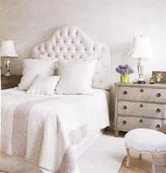 white upholstered headboard