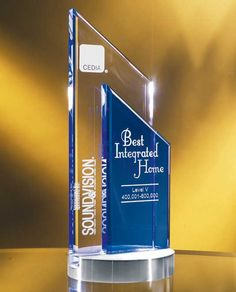 """The Glass Peak Duet Award is a fusion of clear and blue optical glass, deep etched with your custom engraving and logo. The award is elevated on a handsome brushed silver base. This crystal award measures 9.5"""" height and lends itself well to corporate recognition events. Shipping our glass awards anywhere in the world is never a problem.    http://www.edco.com/cat/glass-awards"""