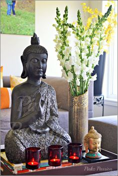 Buddha décor, Buddha heads, Snapdragon flowers, Ikea candle holders ...