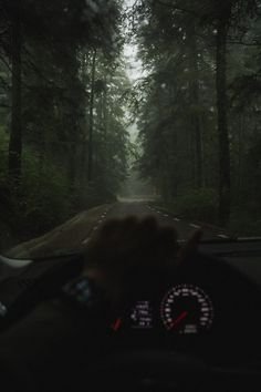 man taking photo of road while driving car