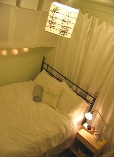 small bedroom.... Like the idea of hang curtains or fabric behind the behind