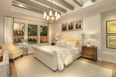 Master bedroom with ceiling beams and chandelier; The Tinsley floor plan, Drees Custom Homes, Austin