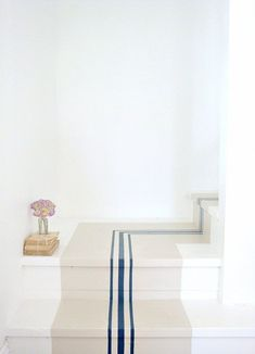Your stairs aren't just a convenient way to get from one floor to another — they're also a blank canvas just waiting for your creative touch. Here are 13 ways to step up your look.